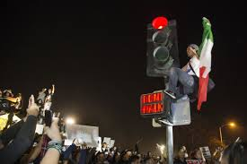 Image result for protestors carrying mexican flags